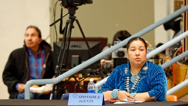Navajo Nation Council Delegate Amber Kanazbah Crotty listens to comments about a bill she sponsored at the winter session on Tuesday in Window Rock, Ariz.