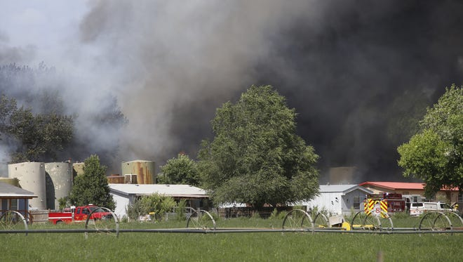 San Juan County firefighters responded to a fire at CBH Trucking and Salvage near the intersection of County Road 5470 and 5467 east of Farmington on Monday.