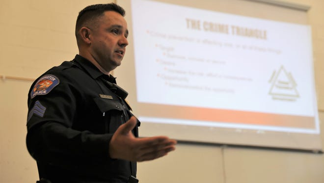 Sgt. Roque Velarde of the Farmington Police Department gives a presentation during a community watch meeting on Thursday at the Sycamore Park Community Center.
