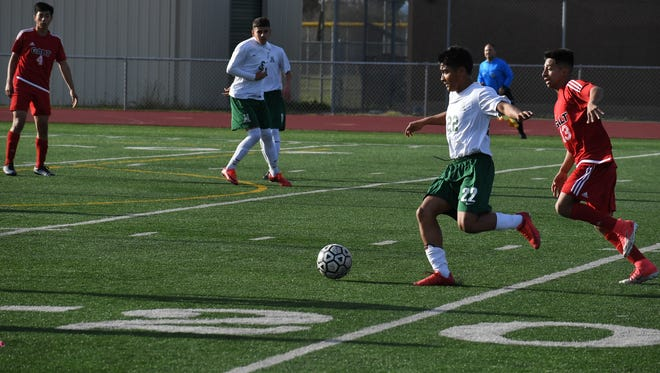 Sophomore Joel Garcia passes the ball to the left side of the penalty area for Alisal. The Trojans' three goals were their first since the CCS Open Division Quarterfinals against Los Altos last week.