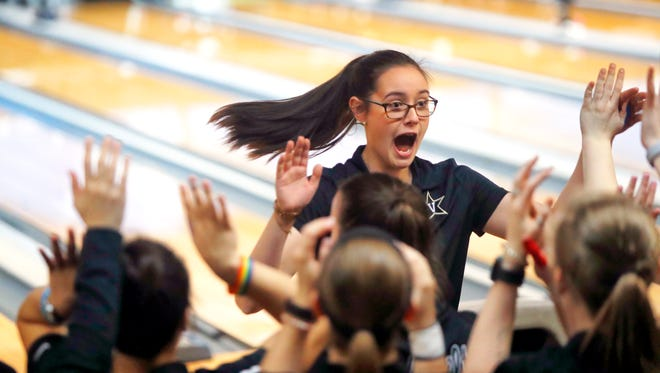 Vanderbilt sophomore bowler Emily Rigney celebrates with her teammates during the Commodores' NCAA semifinal win to advance to the national title match in St. Louis on April 14, 2018.