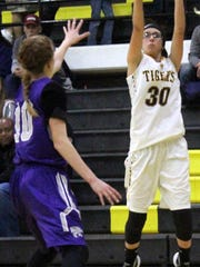 Alamogordo's Faith Silva attempts a three-pointer on Friday night.