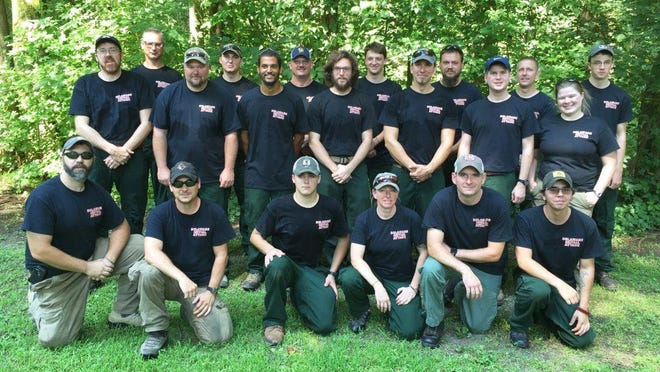 The Delaware wildfire crew at Blackbird State Forest included (front row, from left) Todd W. Shaffer, Samual L. Topper, Christopher S. Riale, Monica Testa, Adam N. Keever and Alexander J. Jenks. In the back row are William T. Seybold (from left), Charles D. Collins, Todd D. Gsell, Nathaniel J. Sommers, Daryl D. Trotman, Scott A. Veasey, Zachary R. Brown, Spencer F. Valenti, Bartholomew D. Wilson, Jeffrey A. Wilson, Daniel A. Mihok, Michael L. Krumrine, Laura K. Yowell and Christopher R. Valenti.