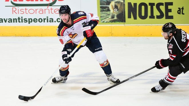 Peoria Rivermen defenseman Tyler Amburgey looks to make a pass during a 14 SPHL game at Carver Arena.