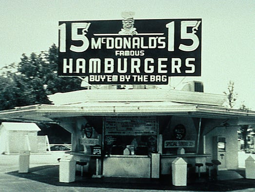 McDonald's: In 1940, brothers Mac and Dick McDonald opened McDonald's Bar-B-Que in San Bernardino, Calif.; eight years later they decided to revamp the restaurant's concept to specialize in their most profitable menu item, hamburgers, and shortened the name to McDonald's. In 1954, Multimixer salesman Ray Kroc visited the restaurant and was blown away by the efficient system developed by the McDonald brothers; he started franchising the brand and bought the company one year later.