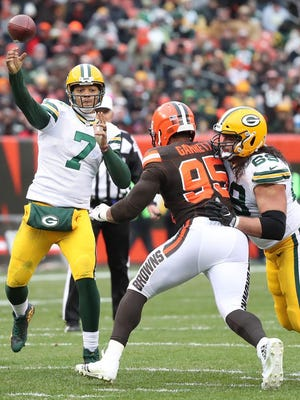 Green Bay Packers quarterback Brett Hundley (7) throws from the pocket as offensive tackle David Bakhtiari (69) blocks Cleveland Browns defensive end Myles Garrett (95) on Dec. 10, 2017 at FirstEnergy Stadium in Cleveland.