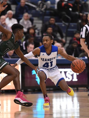 Senior point guard Ja'Quaye James (41) scored 24 points as Teaneck defeated Tenafly, 78-52.