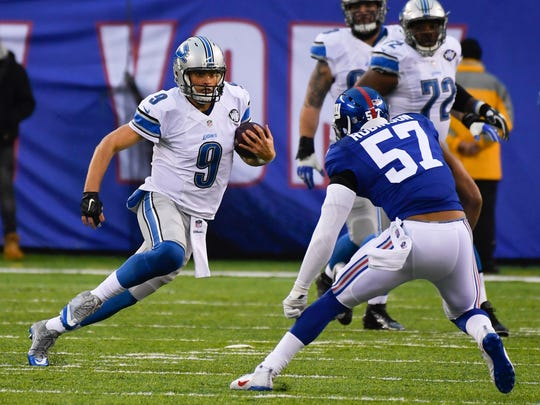 Dec 18, 2016; East Rutherford, NJ, USA; Lions quarterback Matthew Stafford carries the ball as Giants linebacker Keenan Robinson defends during the first half at MetLife Stadium.