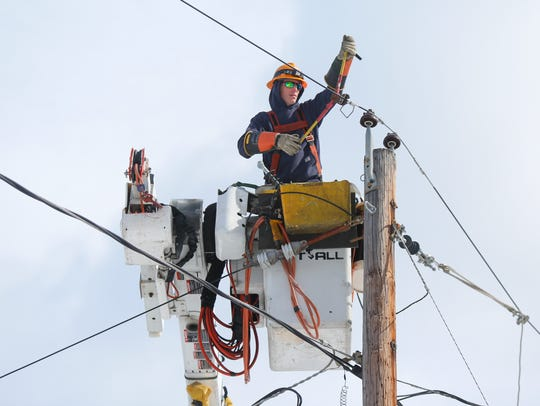 An Orange and Rockland worker cuts power to a primary
