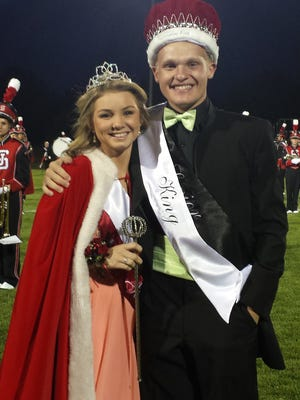 Meredith Robbins, left, and Nick Stahl were crowned Homecoming Queen and King during halftime festivities of the St. Johns football game Sept. 19. The Redwings defeated Mason, 42-21.