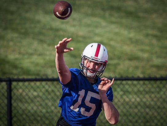 Ball State's Riley Neal runs through drills with teammates