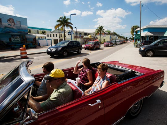 A vehicle eases out into backed up traffic onto Estero Boulevard on Fort Myers Beach on Thursday 11/5/2015.