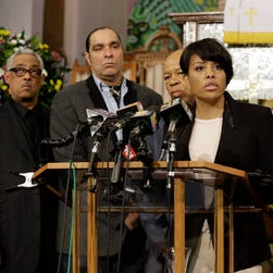 Baltimore Mayor Stephanie Rawlings-Blake speaks in front of faith and community leaders at a news conference Sunday.