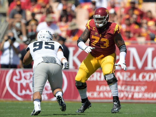 USC Trojans offensive tackle Zach Banner defends against