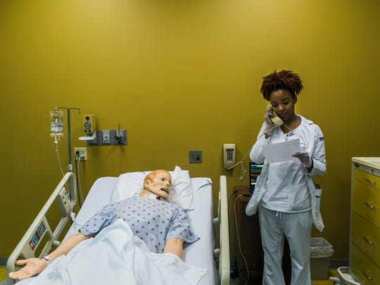 Briana Becton, an Adult 2 nursing student, calls in an order April 6, 2017  for an adult patient simulator in a lab at Baptist College of Health Sciences. This is the third clinical course the junior student is taking at the school. During lab time, Becton and her classmates had to call the doctor, get orders, and with each medication given - had to know what the medication was and why the patient was receiving it. The students are expected to graduate in a year.