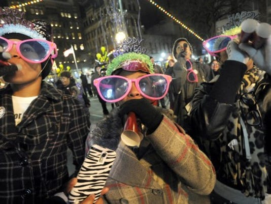 From left: Kristyn Evans, Micah Smith and Kayla Green celebrate the children's countdown at Continental Square in York during the New Year's Eve celebration. YORK DAILY RECORD/SUNDAY NEWS--JASON PLOTKIN