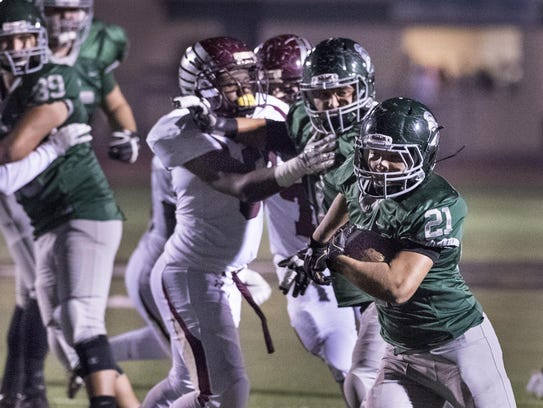 Dinuba's Alek Marroquin runs against Independence in