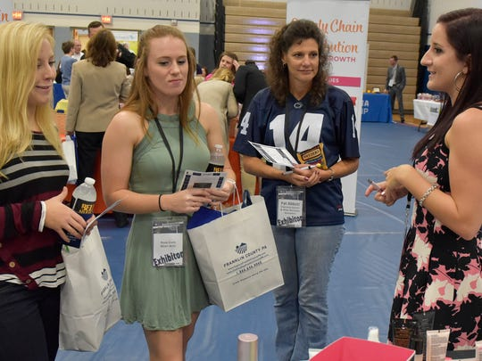Independant beauty consultant Jordan Fox, right, talks to Katie Overdorff, left, Alyssa Munns and Pat Abbott on Thursday, October 20, 2016 at the Chamber Business & Industry Expo at Penn State Mont Alto.