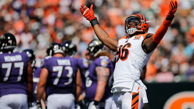 Cincinnati Bengals defensive end Carlos Dunlap (96) signals for noise from the upper deck in the second quarter of the NFL Week 1 game between the Cincinnati Bengals and the Baltimore Ravens at Paul Brown Stadium in downtown Cincinnati on Sunday, Sept. 10, 2017. At the half, the Bengals trailed 17-0.