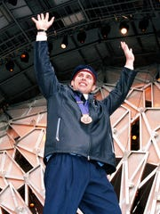 Brian Shimer waves to the crowd at the medals ceremony at the Winter Olympics in Salt Lake City on Feb. 24, 2002. Shimer, a Naples native, was the driver for the USA four-man bobsled team that won bronze.