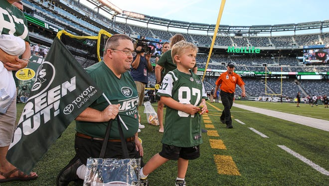 Neal Spickert-Fulton, a 5-year-old Morris Plains cancer patient visits N.Y. Jets/Falcon game at MetLife Stadium as SNYÕs Dream Day winner on August 21, 2015. Neal takes it all in with his father, Shawn Spickert-Fulton, left.