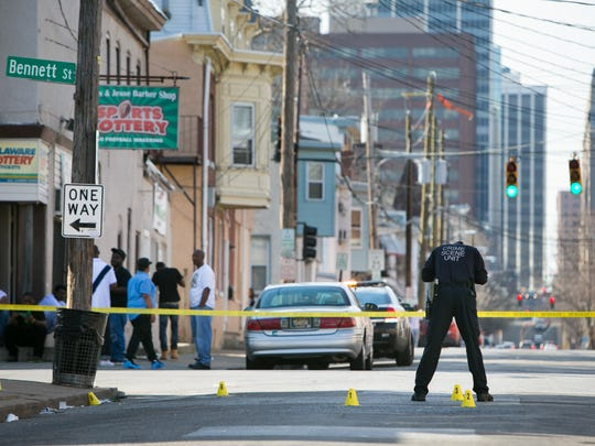 Members of the Crime Scene Unit investigate a shooting at 10th and Bennett Streets in Wilmington.