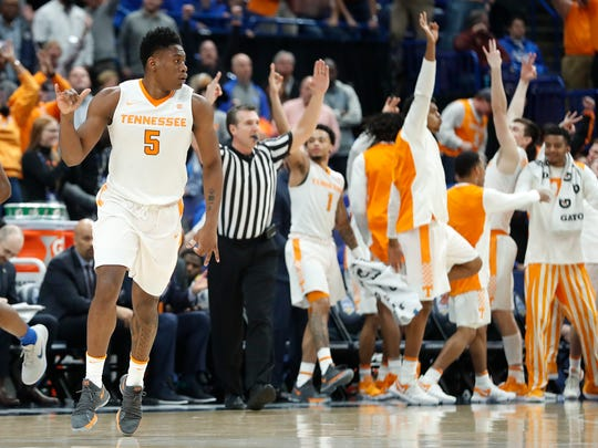 Tennessee forward Admiral Schofield (5) celebrates after a three-point basket against Kentucky during the second half of an NCAA college basketball championship game at the Southeastern Conference tournament Sunday, March 11, 2018, in St. Louis. (AP Photo/Jeff Roberson)