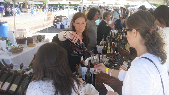 Guests enjoy sampling local wines at last year's festival.