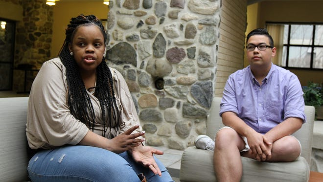 Shanel Anderson, 24, of Manalapan, and Matthew Yee, 20, of Eatontown, both students at Brookdale Community College, Middletown, discuss their issues with saving money.