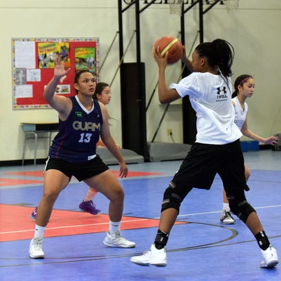 Players from different schools competed against each other during the Guam Basketball Confederation U18 girls' basketball tryouts at the Bishop Baumgartner Memorial School gym in Sinajana on Jan. 31.