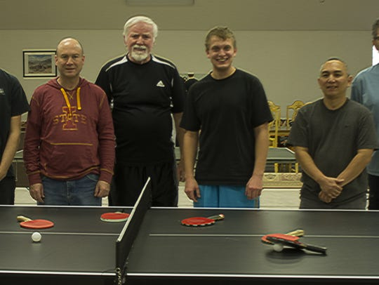 Pictured, from left; Holiday Ping Pong tournament