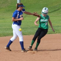 Virgin Valley's Calee Clem is safe at second base after the ball gets away from a Moapa Valley fielder during the teams' game earlier this season.