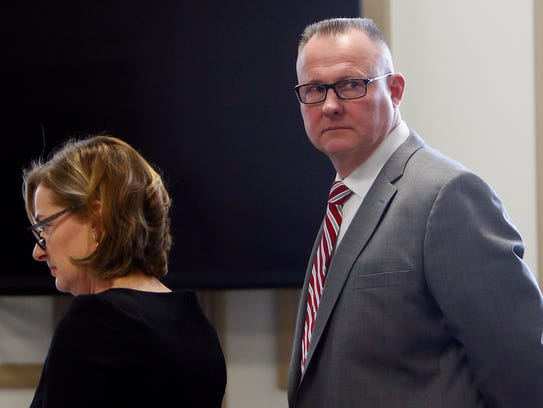 Defense attorney Sharon Bittner Kean with Roger Schneider,
