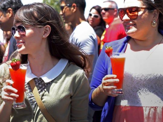 Jennifer Meyers, left, and Janelle Gonzalez, co-workers