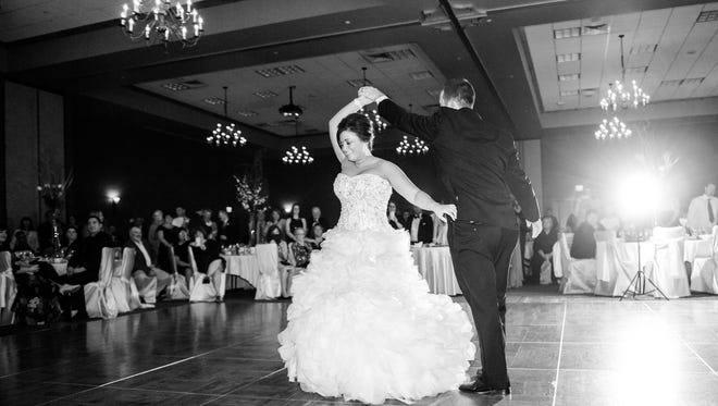 Katie Koenitzer dances with her husband Will during their October wedding.