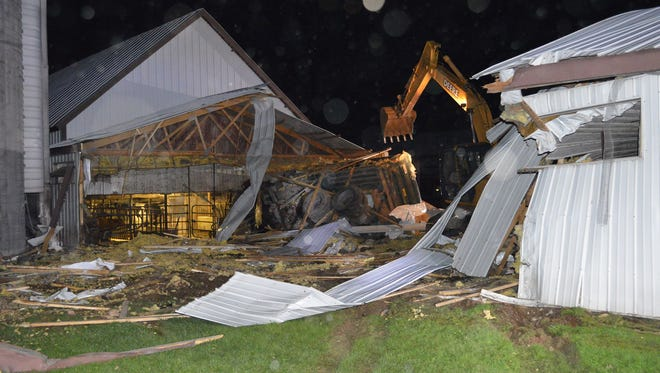 Dump truck crashes into barn in the town of Wausau.