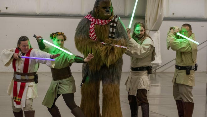 Joshua Beckett, instructional assistant at Claggett Creek Middle School, dresses up as Chewbacca from Star Wars for charity events during his Winter holiday.