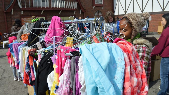 Shoppers check out free  clothing at the Street Store set up in Downtown Indy by a group of Carmel teenagers.
