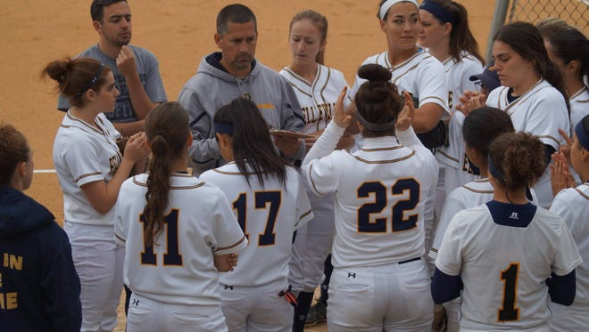Chris Cantarella addressing his team before a game at the Corino Softball Complex on May 20.