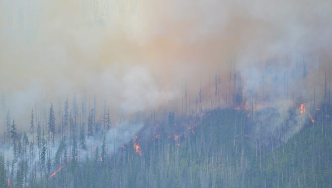 The Howe Ridge fire burns Sunday in Glacier National Park.