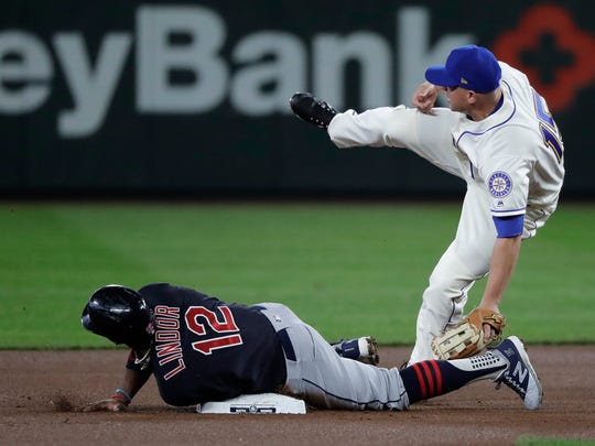 Cleveland Indians' Francisco Lindor (12) safely steals