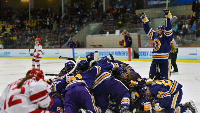 Elmira College celebrates Shannon Strawinski's winning goal March 16 against Plattsburgh State in the NCAA Division III semifinals in Northfield, Vermont.
