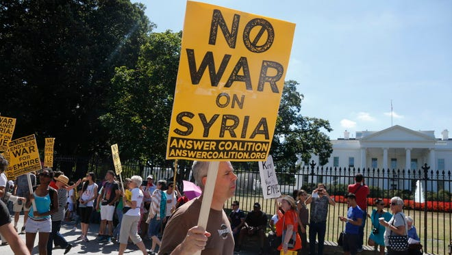 Anti-war demonstrators at the White House in 2013.