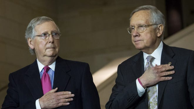 Senate Majority Leader Mitch McConnell, R-Ky., and Senate Minority Leader Harry Reid, D-Nev., stand together on Capitol Hill, February 24, 2016 in Washington, DC.