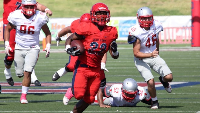 Dixie State redshirt freshman running back Clifford Simms runs for a 45-yard touchdown in the second quarter vs. Western State Colorado on Saturday, Oct. 1, 2016 at Legend Solar Stadium.