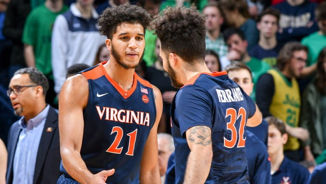 Virginia forward Isaiah Wilkins (21) and guard London Perrantes (32) celebrate in the second half against Notre Dame.