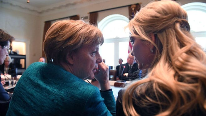 German Chancellor Angela Merkel, left. speaks with Ivanka Trump during a roundtable discussion on vocational training with United States and German business leaders in the Cabinet Room of the White House on March 17, 2017.