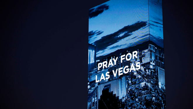 The marquee at the W Hotel shows a sign for the victims of a mass shooting on Wednesday, Oct. 4, 2017, in Las Vegas.