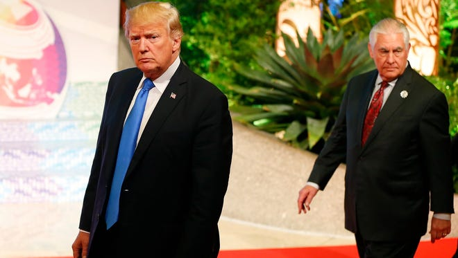 President Trump, left, accompanied by State of Secretary Rex Tillerson, arrives in the Philippines for an economic summit in Manila on Nov. 14.