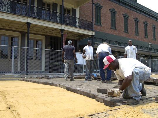 Workers rebuild the brick street of Front Street in Natchitoches in 2008.